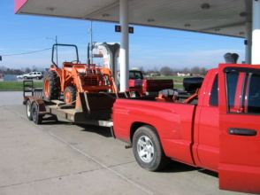 The L2250 Kubota tractor being pulled by the very brave Dodge Dakota, being driven by an even braver driver!